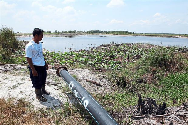 Water for peat swamp: The Forestry Department intends to tap water from this pond nearest to the Raja Muda Forest Reserve to prevent the peat land from getting too dry to reduce the risk of fires during the hot season. A pump will be fitted to the pipe to draw water for peatland irrigation.